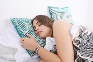 Woman sleeping on bed.