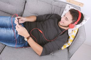 Man listening music with tablet.