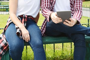 Couple using digital tablet.