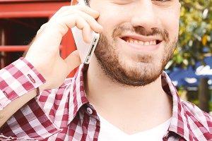 Latin man talking on the phone.