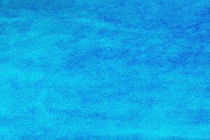 Blue textured background.