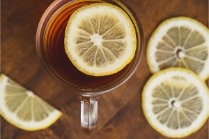 Top view of black tea with lemon in