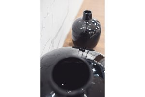 two black tall ceramic vases