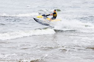 Young man riding on jet ski