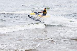 Young man riding on jet ski