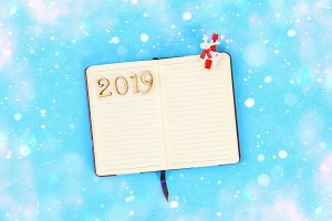 2019 year. Blank notepad. Plans and