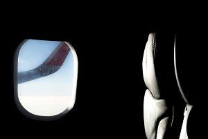 Blue Sky through a Flight Window