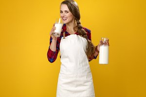 smiling woman cook having glass of h