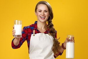 smiling woman cook giving glass of h