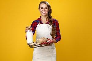 woman farmer showing sliced fresh br