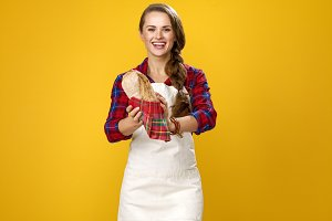 woman cook isolated on yellow backgr