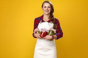 smiling modern woman farmer with jar