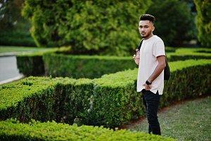 Stylish indian beard man at black le