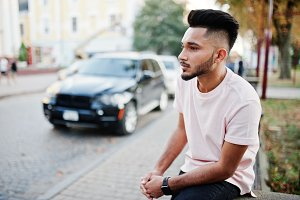 Stylish indian beard man at pink t-s