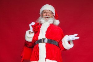 Christmas. Smiling Santa Claus held