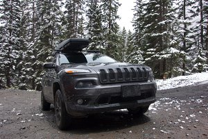 Dirty Jeep Cherokee in Forest