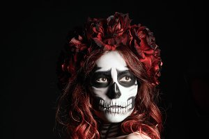 Woman with muertos (calavera) makeup