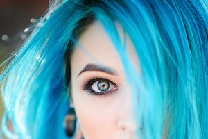 Beautiful young woman with blue hair