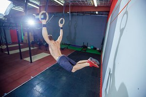 Muscle-up exercise young man doing