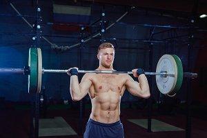 Muscular fitness man preparing to