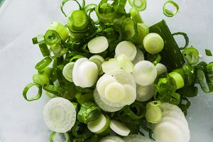 chopped green onions in a glass bowl