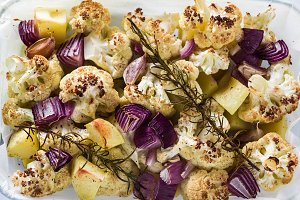 baked autumn vegetables in a glass b