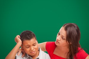 Blank Chalkboard Behind Hispanic Boy