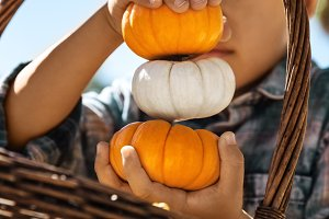 Child With Straw Basket And Pumpkins