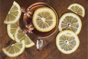 Top view of black tea with lemon in
