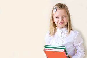 Smart school-age child with books.