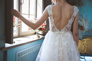 Bride is dressing the dress.