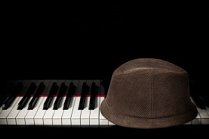 Hat on piano keyboard