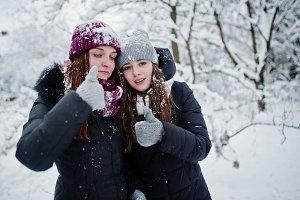 Two funny girls friends having fun a