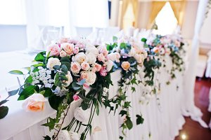 Flowers on table of newlyweds at wed