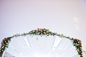 Elegant wedding arch of table newlyw