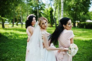 Bride posed on park with two cute br