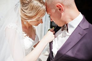 Bride tie buttonhole for her groom a