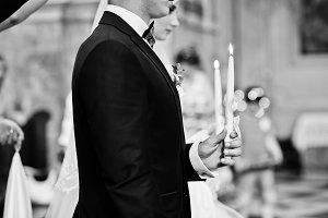 Wedding couple at church with burnin