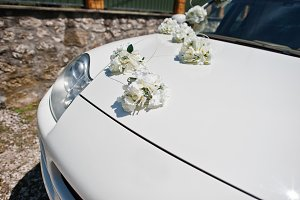 White flowers decoration on the hood