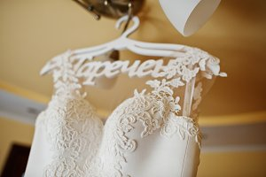 White wedding dress at hangers on th