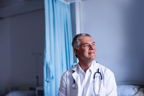 Thoughtful doctor sitting in ward