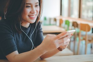 Asian woman listening music