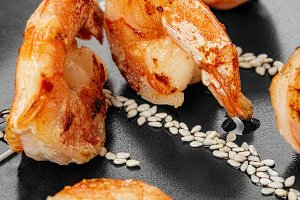 Shrimp on a black plate