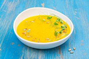 Pumpkin soup on blue wooden table
