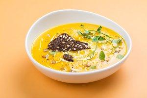 Pumpkin soup on autumn background