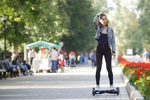 Girl riding a gyro in the park