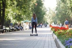 Slender beautiful girl riding a gyro