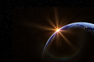 Planet earth with the sun and stars,