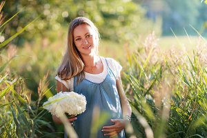 Young pregnant woman expecting baby