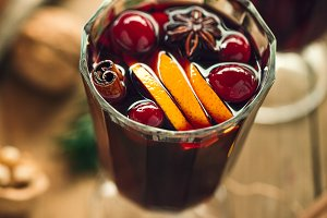 Mulled wine in glasses on blue table